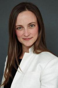 Professional headshot of Vanessa Shay wearing a white blazer